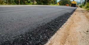 Why is soil stabilization essential when building roads?