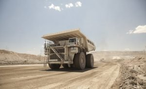 Why should we dust control on unpaved mining roads?